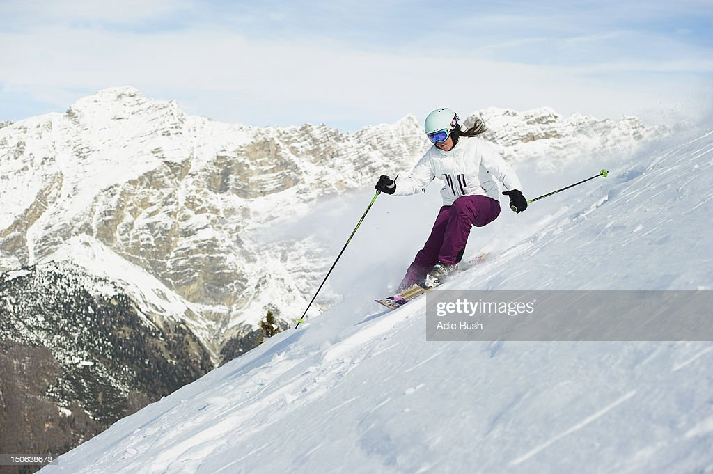 Skier skiing on snowy slope : Stock Photo