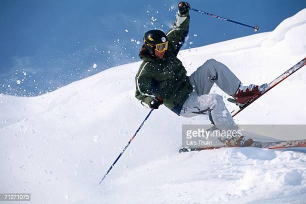 a skier skiing. - chute ski photos et images de collection