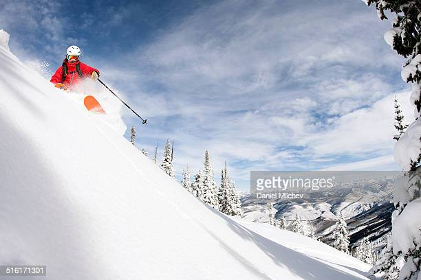 skier skiing steep run on a powder day. - beaver creek colorado stock pictures, royalty-free photos & images