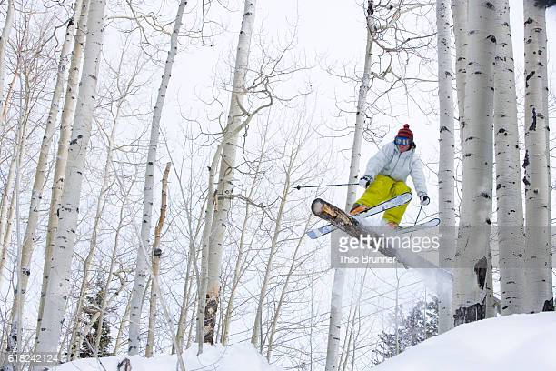 Skier sliding on log