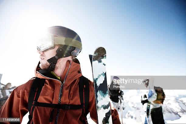 skier standing on mountain top of the marmolada - sci sci e snowboard foto e immagini stock