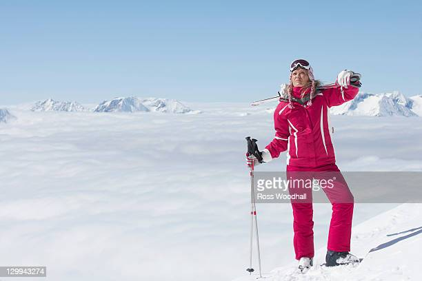 skier standing on mountainside - ski wear stock pictures, royalty-free photos & images