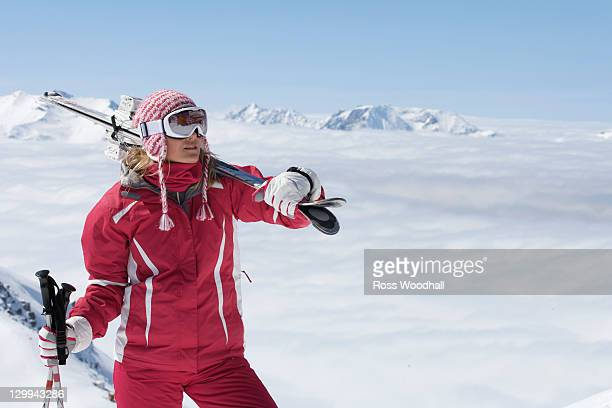 Skier standing on mountainside