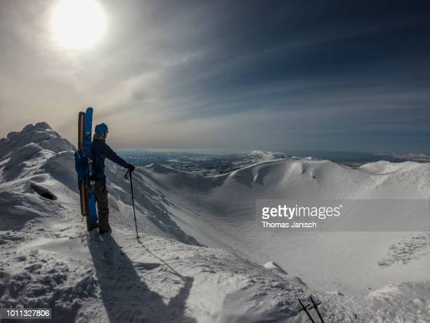 skier standing on the summit of mount yotei and looking into the snow covered crater, japan - hokkaido stock pictures, royalty-free photos & images
