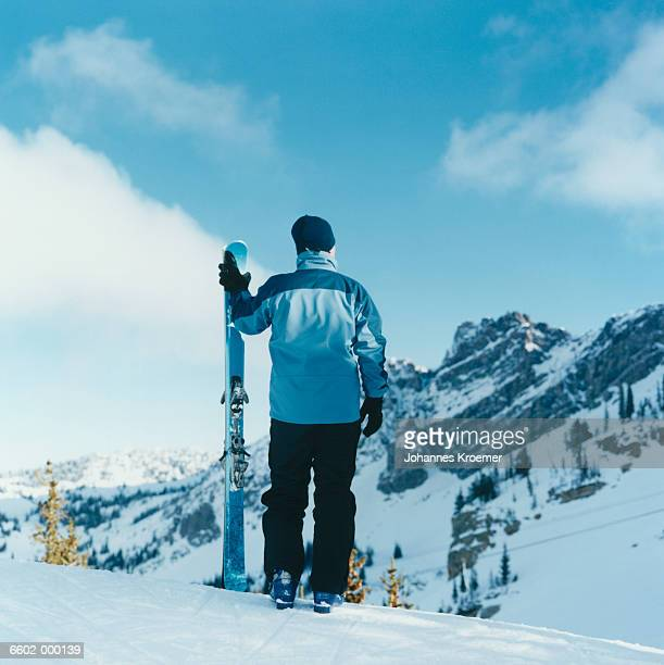 Skier Standing with Skis