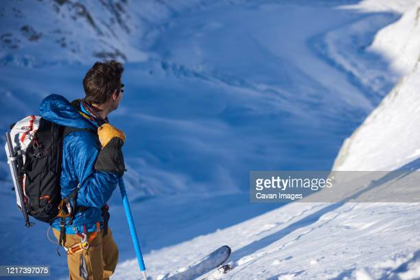 skier stood still looking at mer de glace glacier - chamonix stock pictures, royalty-free photos & images