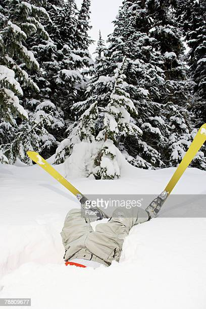skier stuck upside down in snow - funny snow stock photos and pictures