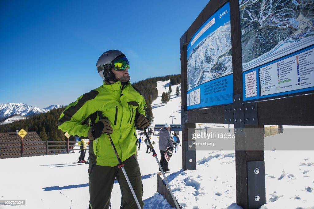 A skier views a map at a Vail Resorts Inc. location in Vail,... News ...