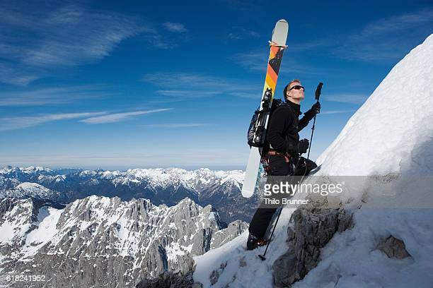 Skier walking up hill