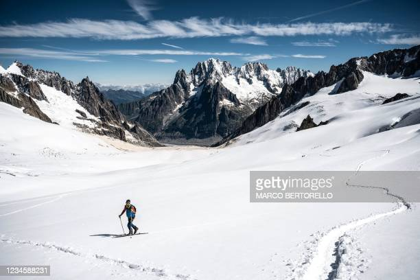 Skier walks on the glacial troughs the Vallee Blanche in the Mont Blanc Massif on August 6, 2021.