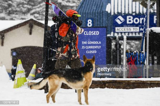 Skier walks past a closed gondola at a Vail Resorts Inc. Location in Vail, Colorado, U.S., on Thursday, March 19, 2020. Colorado Governor Jared...