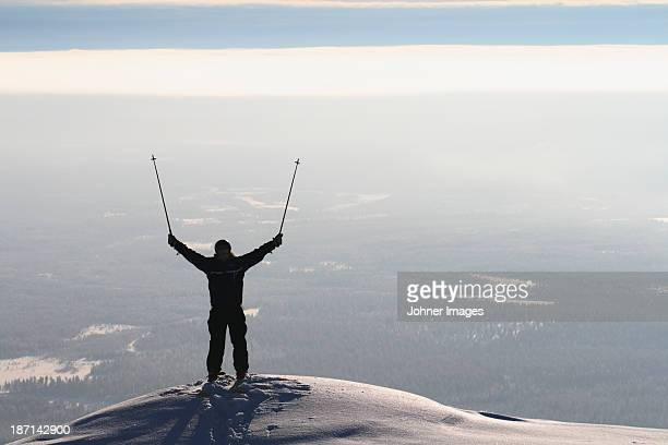 A skier with reached arms, Sweden.