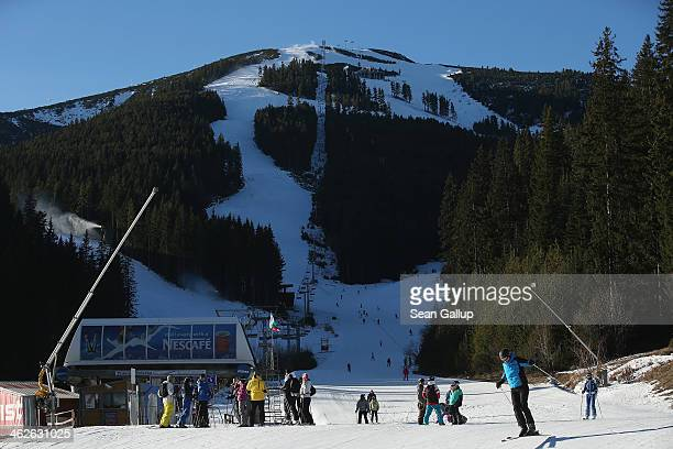 Skiers and snowboarders enjoy sunny weather at the Bansko ski resort on January 13 2014 in Bansko Bulgaria Located in the Pirin mountains in southern...
