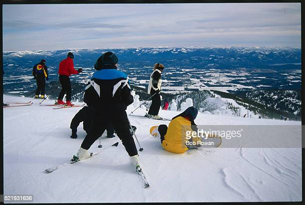 Skiers and Snowboarders on Ski Slope