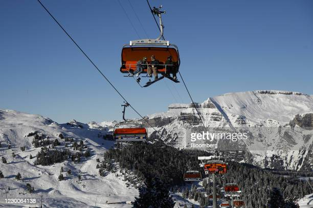 Skiers and snowboarders ride chairlifts at the Kleine Scheidegg ski resort in Grindelwald, Switzerland, on Thursday, Dec. 10, 2020. The pandemic has...