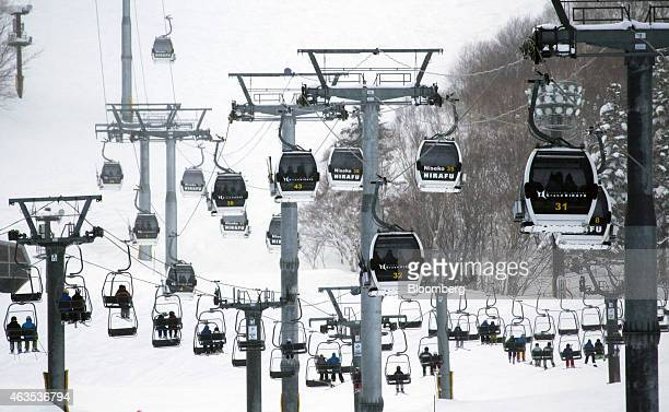 Skiers and snowboarders ride the lift at the Grand Hirafu resort operated by Tokyu Resort Service Co in Kutchan Hokkaido Japan on Saturday Feb 14...