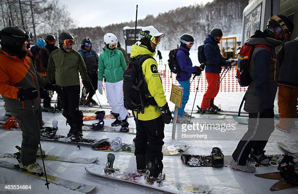 Skiers and snowboarders wait for the operation of the lift at the Niseko Hanazono resort operated by Nihon Harmony Resorts KK in Kutchan Hokkaido...