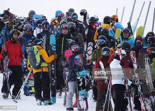 Skiers and snowboarders wait in line to ride the lift at the Grand Hirafu resort operated by Tokyu Resort Service Co in Kutchan Hokkaido Japan on...