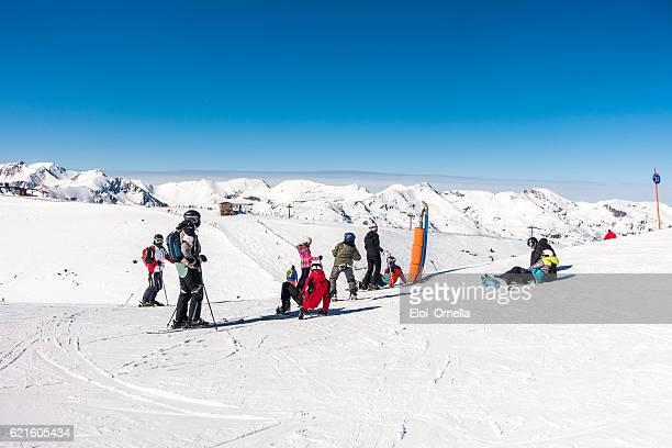 skiers andorra snowboarders clear sky snow ski slope