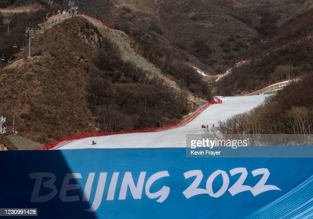 Skiers are seen on the course at the National Alpine Ski Center where alpine events for the Beijing 2022 Winter Olympics are to be held in Yanqing...