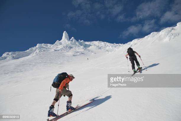 Skiers ascend the Northeast flanks of Mt Augustine