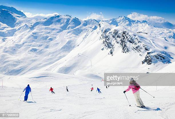 skiers at meribel in the three valleys - trois vallees stock pictures, royalty-free photos & images