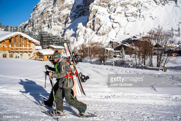 Skiers at the start of a ski touring run on January 18, 2021 in Val-d'Isere, France. The Val d'Isère resort has set up a secure ski touring area in...