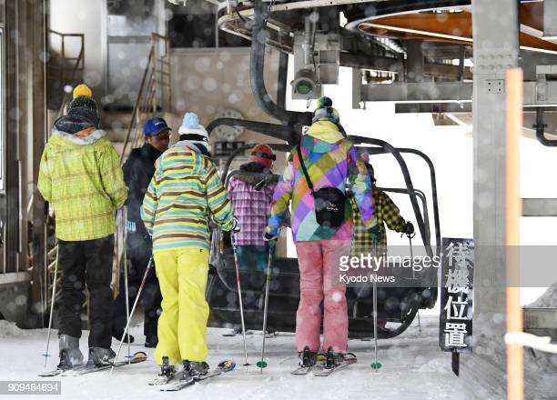 Skiers board a ski lift and head for the slopes at a ski resort near Mt MotoShirane in Gunma Prefecture in eastern Japan on Jan 24 a day after the...