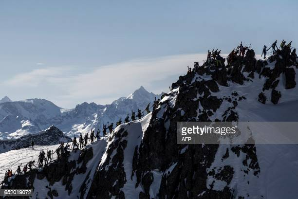 Skiers compete during the 4th and last stage of the 32nd edition of the Pierra Menta ski mountaineering competition on March 11 2017 in...