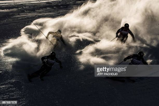 Skiers compete during the FIS Men Ski Cross World Cup on December 7 2017 at the ValThorens ski resort in the French Alps PACHOUD