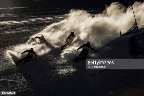 TOPSHOT Skiers compete during the FIS Men Ski Cross World Cup on December 7 2017 at the ValThorens ski resort in the French Alps PACHOUD