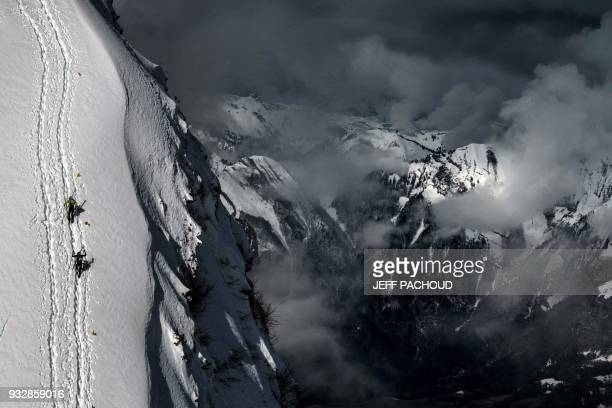 TOPSHOT Skiers compete during the third stage of the 33rd edition of the Pierra Menta ski mountaineering competition in ArechesBeaufort on March 16...