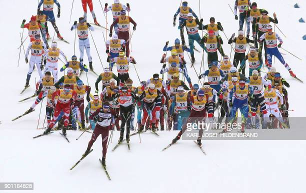 Skiers compete in the men's 15 kilometer Mass Start free style race of the 'Tour de Ski' Cross Country World Cup on January 4 2018 in Oberstdorf...