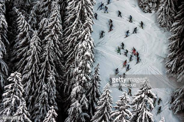 TOPSHOT Skiers compete on March 14 2018 during the first stage of the 33rd edition of the Pierra Menta ski mountaineering competition in...