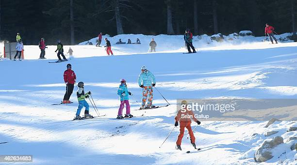 Skiers descend a slope at the Bansko ski resort on January 13 2014 in Bansko Bulgaria Located in the Pirin mountains in southern Bulgaria the resort...