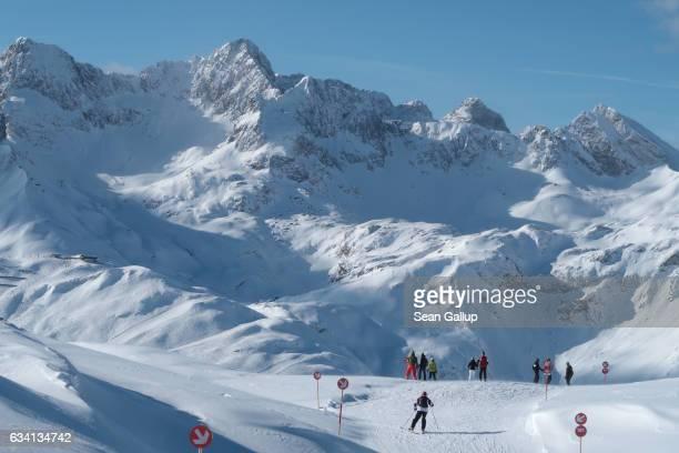 Skiers descend from the Ruefikopf summit at the LechArlberg ski resort on February 2 2017 near Lech Austria The LechArlberg resort which incorprates...