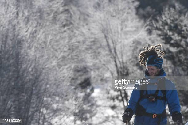 Skier's dreadlocks are seen backlit against frozen trees on February 11, 2021 in Aviemore, United Kingdom. The village of Carrbridge in Badenoch and...