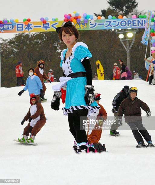 Skiers dressed in costume enjoy the snow at Yeti ski park on October 18, 2013 in Susono, Japan. Yeti is the first ski park in Japan to open this...