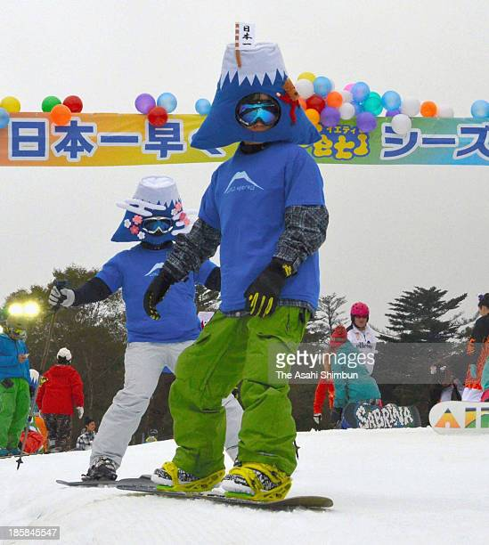 Skiers dressed in Mt. Fuji costume enjoy the snow at Yeti ski park on October 23, 2013 in Susono, Japan. Yeti is the first ski park in Japan to open...