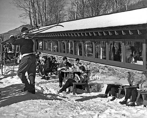 Skiers enjoy their beverages and the sunshine after a day on the slopes Manchester Vermont late 1950s