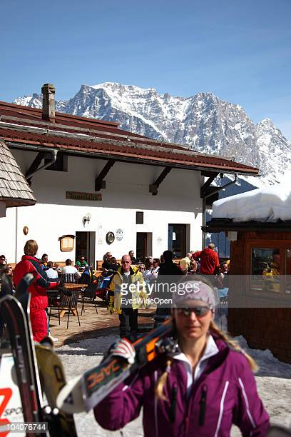 Skiers enjoying the sun at the terrace of the ski hut restaurant Brettlalm on March 19 2010 in Lermoos Tyrol Austria