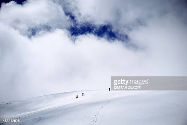 Skiers enjoys the slops of the Pirin Mountains on March 3, 2015. Bulgaria receives more than 13% of its GDP from low-cost tourism in its three major...