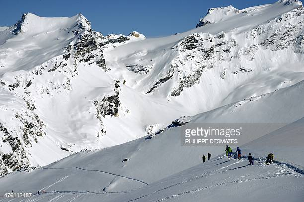 Skiers freeride down an offpiste slope despite a high avalanche risk at the ski resort in Vald'Isere in the French Alps on March 2 2014 AFP PHOTO /...