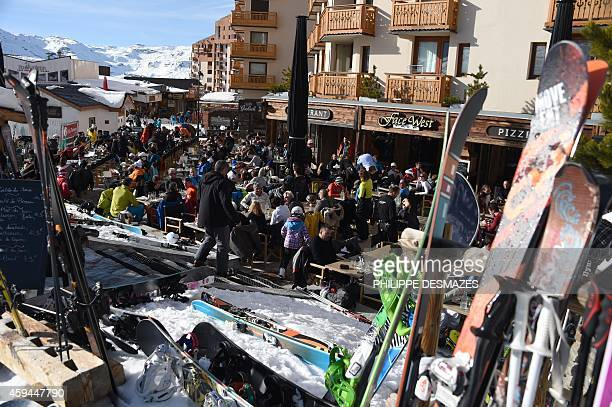 Skiers gather at a restaurant on the opening weekend of the ski season on November 22 2014 at Val Thorens ski station in the French Alps AFP...