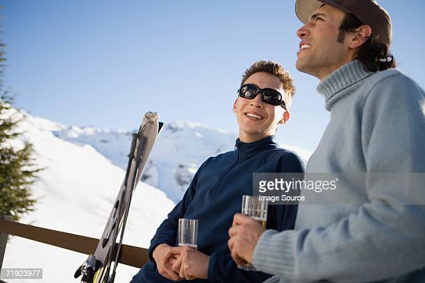 skiers having a drink - apres ski stock pictures, royalty-free photos & images