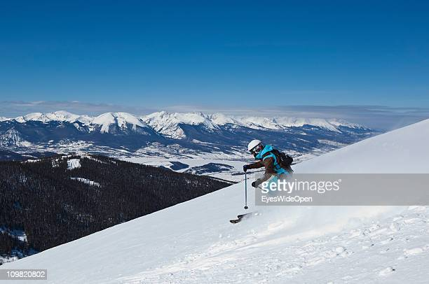 Skiers in action in powder snow at Kat which offers Cat skiing on February 04 2011 in Keystone near Vail Colorado United States Untouched champagne...