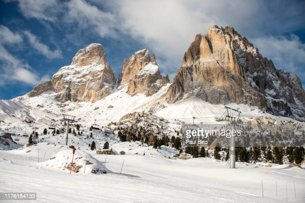 skiers in the dolomites , val gardena, northern italy - alpi foto e immagini stock