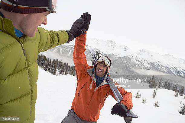 skiers in the mountains - winter sport stock pictures, royalty-free photos & images