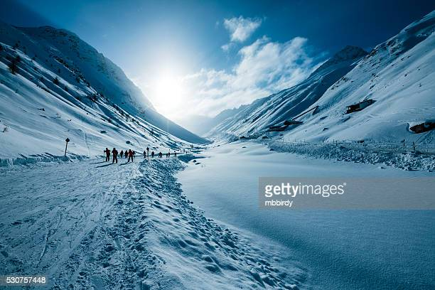 Skiers in valley of ski resort Soelden, Tirol, Austria