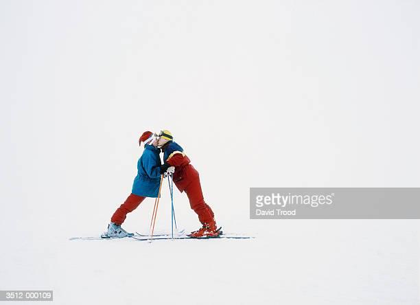 Skiers Kissing